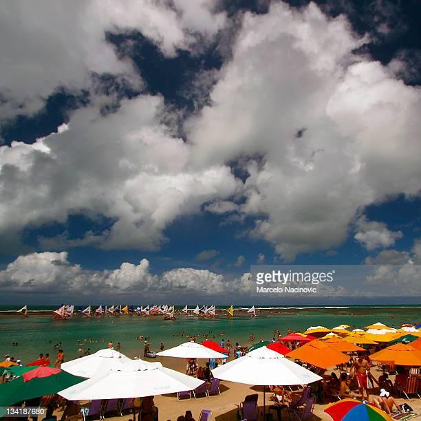 beach umbrellas and chairs - porto galinhas stock photos and pictures