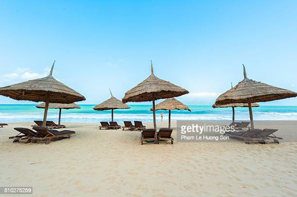 Beach umbrellas and deck chairs on beach