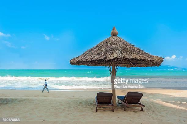 Beach umbrellas and deckchairs on beach