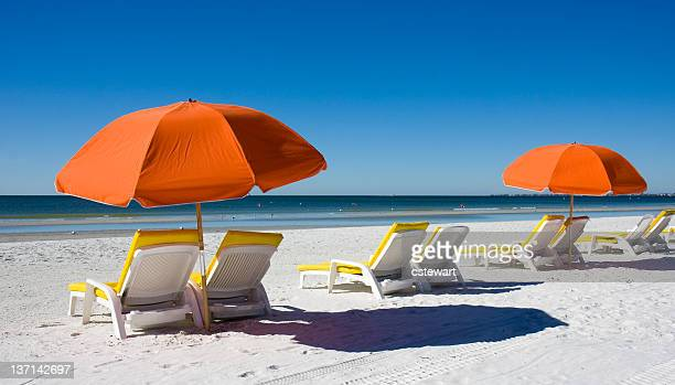 beach umbrellas and lounge chairs - fort myers beach stock pictures, royalty-free photos & images