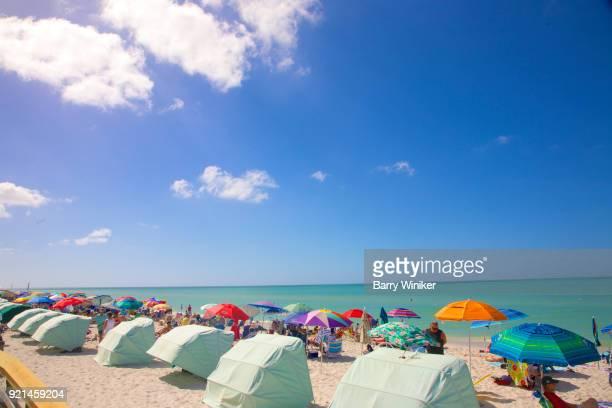 beach umbrellas cabanas blue sky