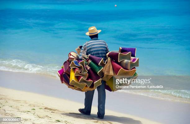 beach vendor with goods to sell - souvenir stock pictures, royalty-free photos & images