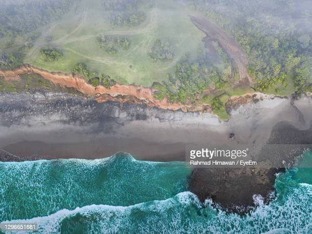 beach view from the air with calm waves during the day in north bengkulu, indonesia - rahmad himawan stock pictures, royalty-free photos & images