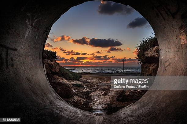 Beach viewed through from a pipe