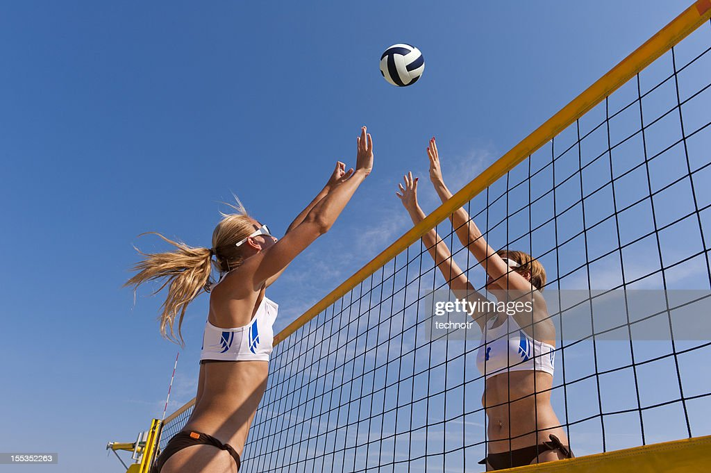 Beach volley action on the net : Stock Photo
