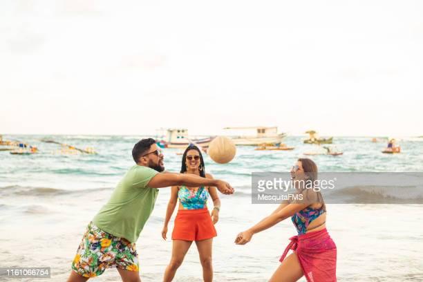 beach volley on porto de galinhas beach - porto galinhas stock photos and pictures