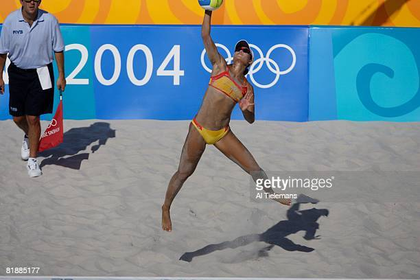 Beach Volleyball: 2004 Summer Olympics, China Tian Jia in action, serve during Preliminary Round with teammate Wang Fei at Olympic Beach Volleyball...
