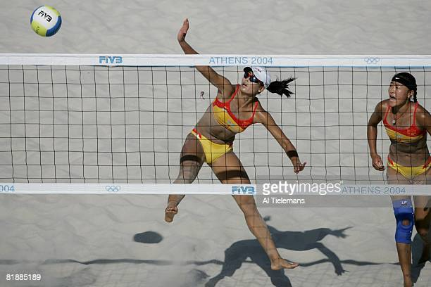 Beach Volleyball: 2004 Summer Olympics, China Tian Jia in action with teammate Wang Fei during Preliminary Round at Olympic Beach Volleyball Centre...