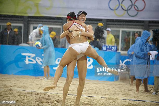 2008 Summer Olympics USA Kerri Walsh victorious hugging teammate USA Misty MayTreanor after winning Women's Gold Medal Match vs China at Chaoyang...