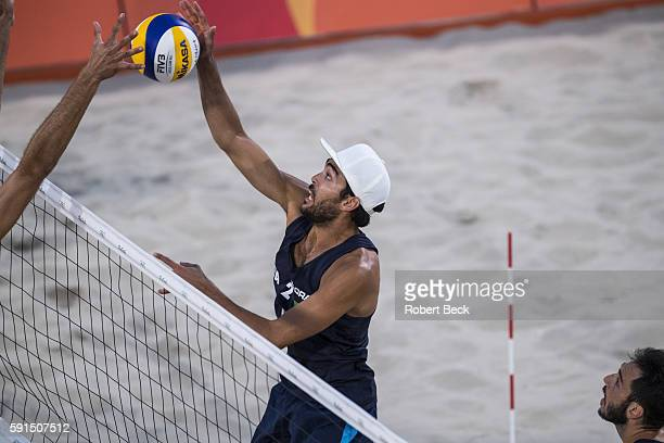 Summer Olympics: Italy Daniele Lupo in action vs USA during Men's Preliminary Round - Pool A match at Beach Volleyball Arena. Rio de Janeiro, Brazil...