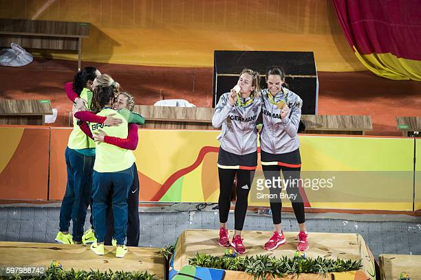 2016 Summer Olympics View of Germany Laura Ludwig and Kira Walkenhorst victorious with medals during presentation ceremony after winning Gold in the...
