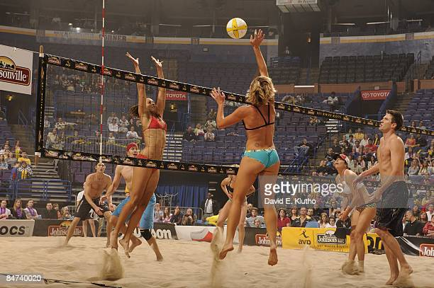 Hot Winter Nights Indoor: Rear view of Carrie Dodd in action, spike vs Jenny Johnson Jordan during coed final exhibition match at Scottrade Center....
