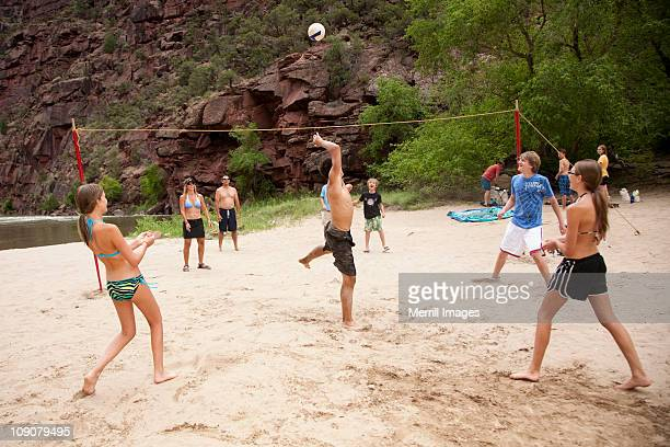 Beach volleyball game by Green River