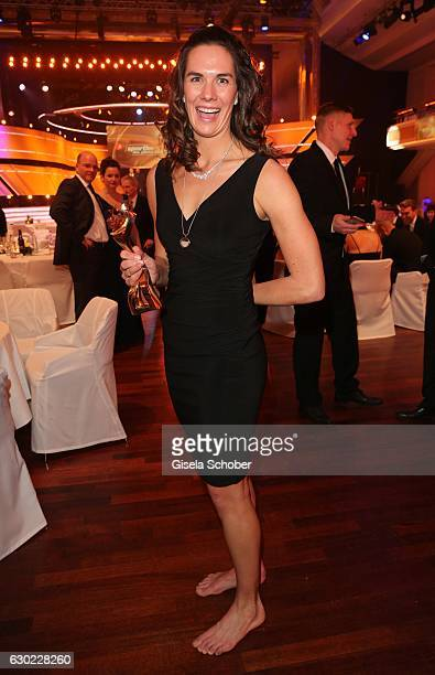 Beach volleyball Olympic gold medalist, champion Kira Walkenhorst with award during the 'Sportler des Jahres 2016' Gala at Kurhaus on December 18,...