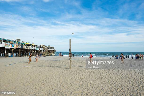 beach volleyball on cocoa beach - cocoa beach stock pictures, royalty-free photos & images