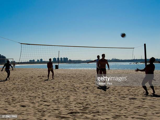 beach volleyball - young men in speedos stock photos and pictures