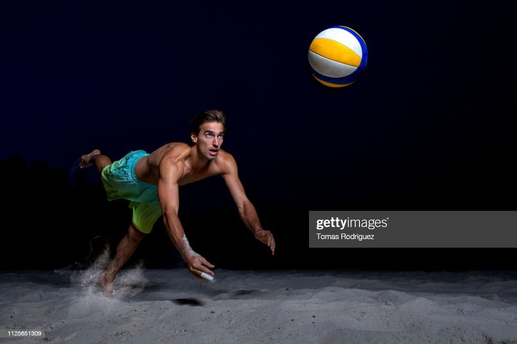 Beach volleyball player digging the ball : Stock-Foto