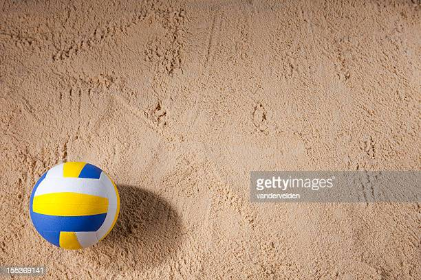 beach volleyball sitting on the sand - beachvolleybal stockfoto's en -beelden