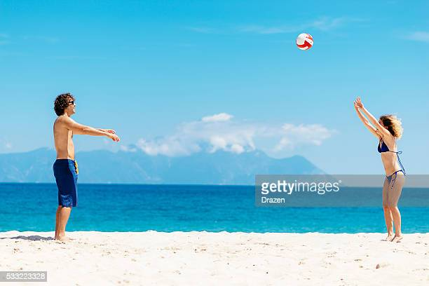 beach volleyball with friends on greek islands - beach volleyball stock pictures, royalty-free photos & images