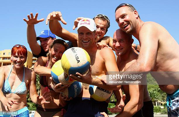 Beach volleyball World Champion Julius Brink poses prior to a fun beach volleyball match against 6 World Champions and Olympic medalist Kati Wilhelm...