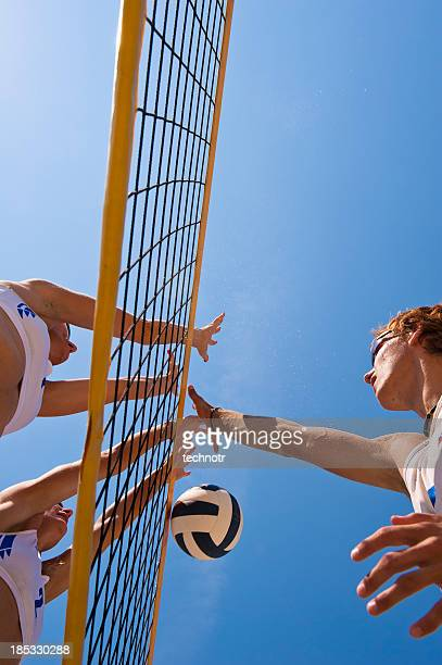 Beach volleying net action