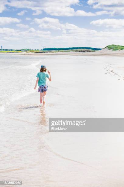 beach walk - headwear stock pictures, royalty-free photos & images