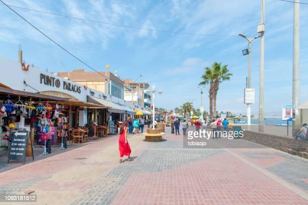 beach walk street in paracas, peru - pisco peru stock photos and pictures