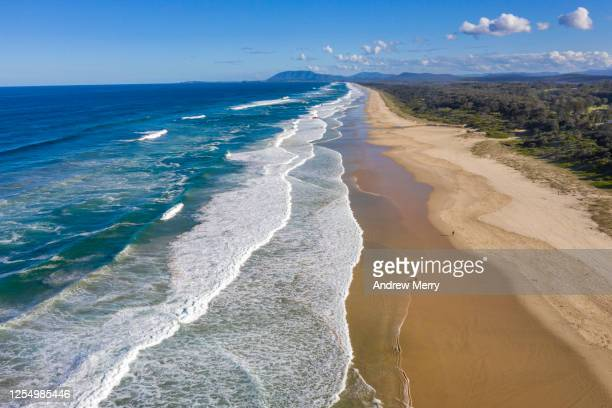 beach, wave, blue sky and coastline in australia, aerial view - port macquarie stock pictures, royalty-free photos & images