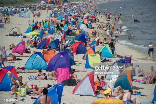 Beach weather on the isle Usedom in Zinnowitz, Germany, 08 August 2014. Photo: Stefan Sauer/dpa | usage worldwide