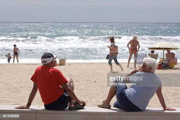 Beach with bathers and spectators in Le Lavandou on June 19 2014 in Le Lavandou France