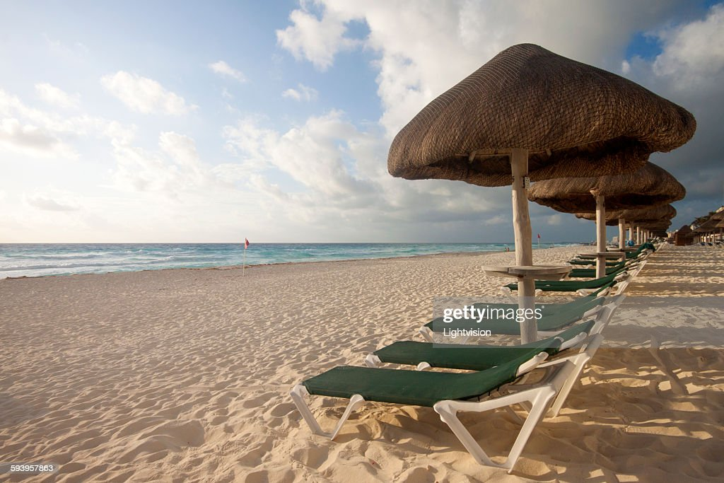 Beach with beach chairs : Stock Photo