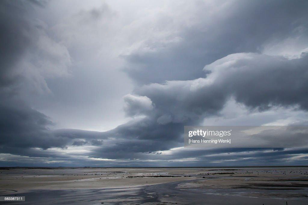 Beach with dramatic sky : Stock Photo
