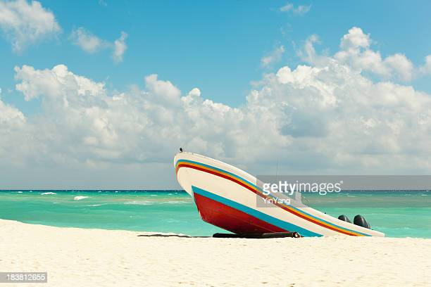beach with fishing boat on caribbean sea, playa del carmen - mayan riviera stock photos and pictures