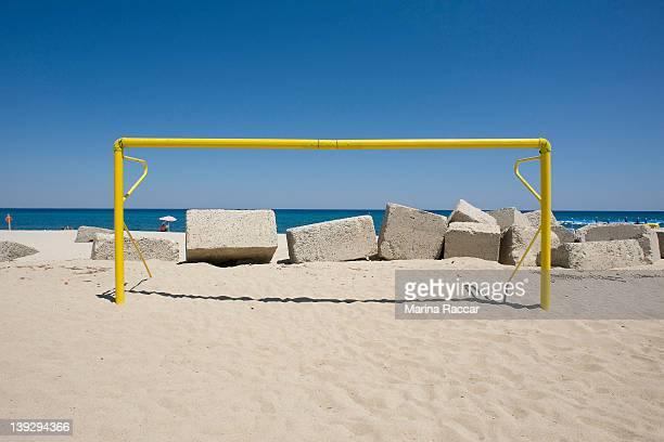 Beach with football goal