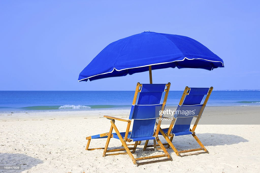 Beach with Lounge Chairs and Umbrella : Stock Photo