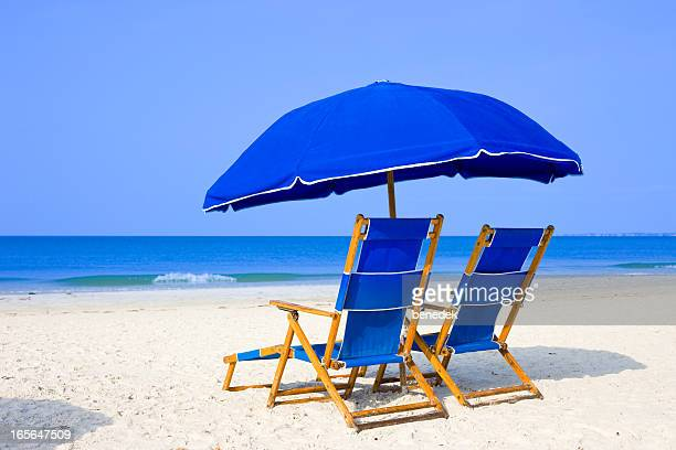 Beach with Lounge Chairs and Umbrella