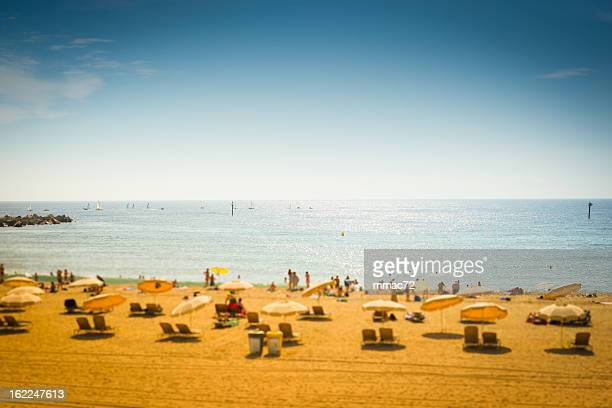 Beach with Parasol in Barcelona, Spain