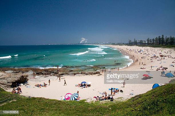 beach with port kembla industrial area in background, wollongong, new south wales, australia - wollongong stock pictures, royalty-free photos & images