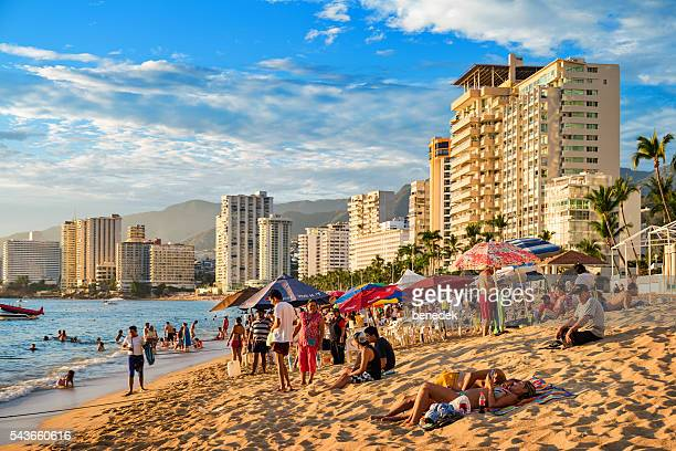 Beach with Row of Hotels and People in Acapulco Mexico