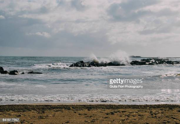 Beach with stormy sea in Rimini, Italy