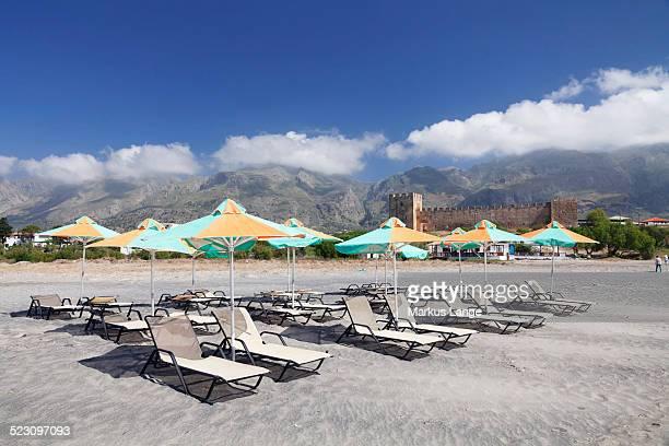 Beach with sun beds, the Venetian castle at the back, Frangokastello, Crete, Greece