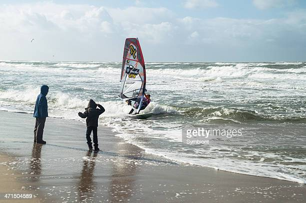 Beach with Windsurfer in the Waves