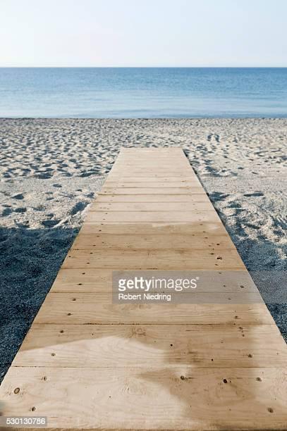 Beach wooden boardwalk Italy ocean empty