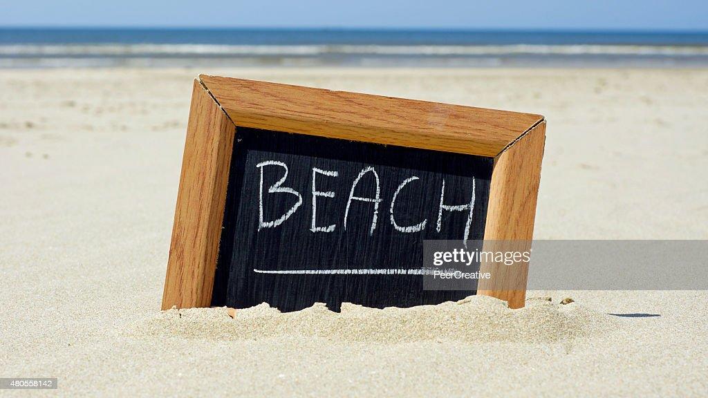 Beach written : Stock Photo