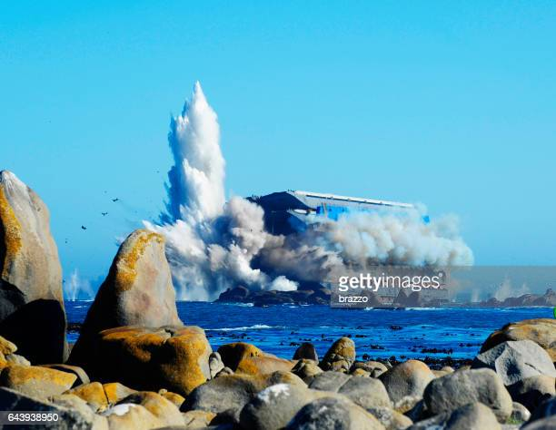 beached ship explodes at sea - stranded stock photos and pictures