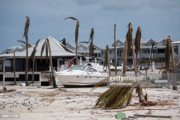 TOPSHOT A beached speedboat lies among debris in the Baie Nettle area of Marigot on Saint Martin island on September 12 after it was devastated by...