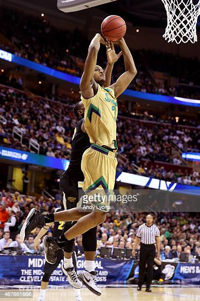 J Beachem of the Notre Dame Fighting Irish drives to the basket against Rashard Kelly of the Wichita State Shockers in the first half during the...