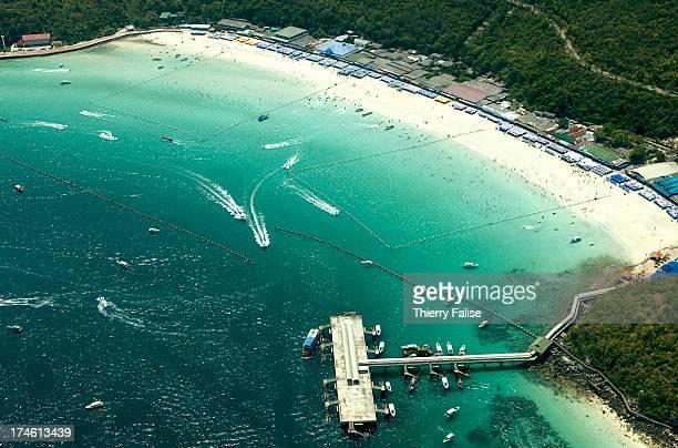 Beaches and a jetty on Ko Lan, an island off Pattaya, a main tourist resort on the Gulf of Thailand..