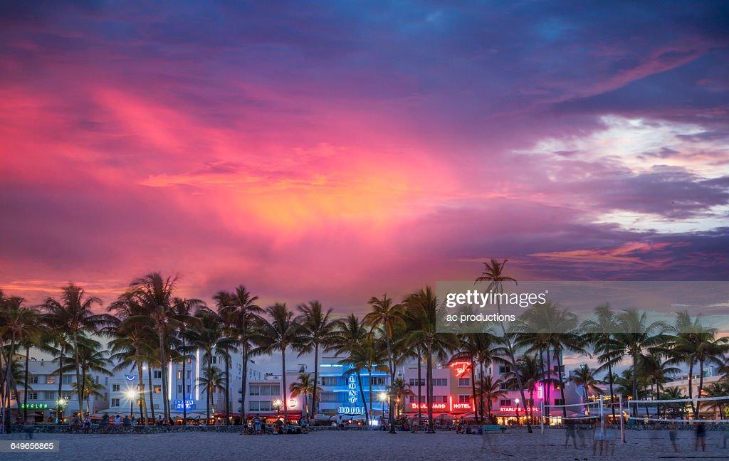 Beachfront buildings under sunset sky : Stock Photo