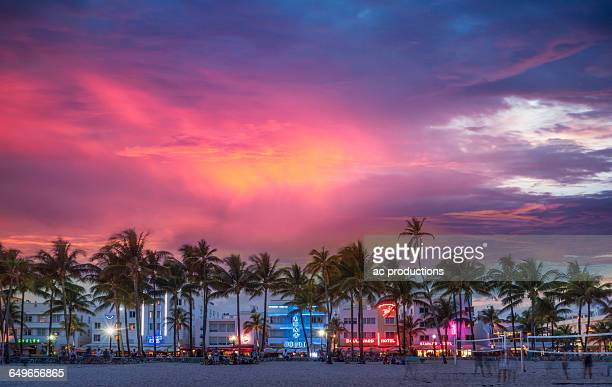 Beachfront buildings under sunset sky